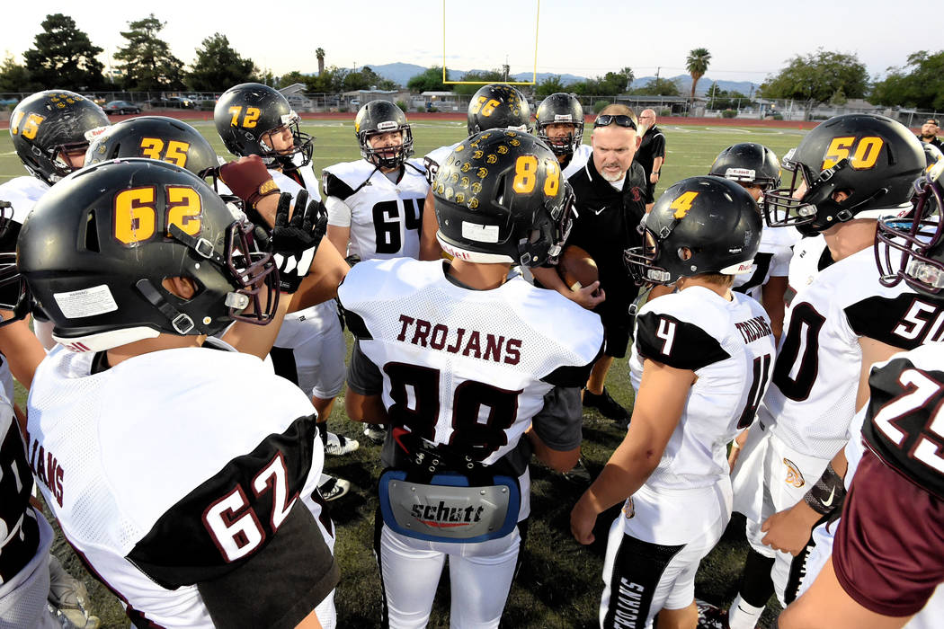 Pahrump Valley football players gather around coach Joe Clayton for a pregame talk before taking on Democracy Prep, the first of what has become three consecutive wins in Sunset League games for t ...