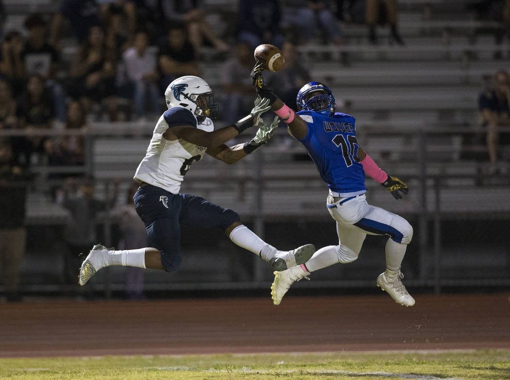 Basic's Franco Mays Jr. (10), right, deflects a pass intended for Foothill's Jordan Wilson (6) during the first half of a varsity football game at Basic High School in Henderson on Friday, Oct. 5, ...