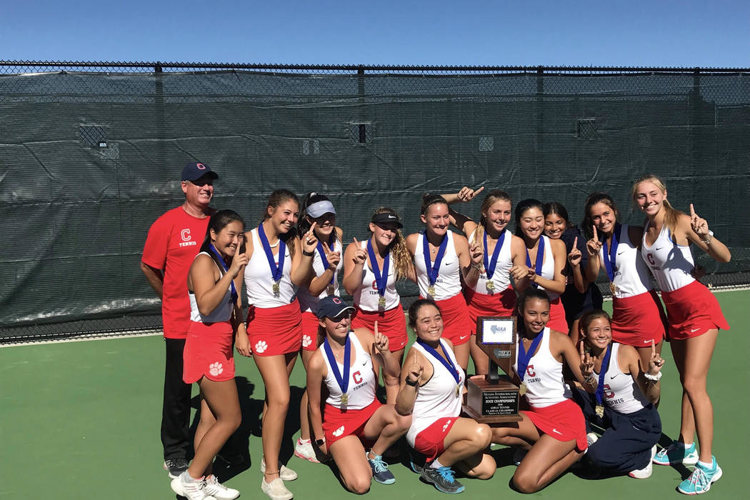 Coronado's girls tennis team poses for a photo with the Class 4A state championship trophy after a 15-3 victory over Palo Verde at Bishop Manogue High School on Friday, October 19.