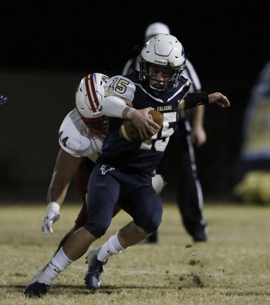 Liberty High's defensive end Luke Toomalatai (44) tackles Foothill's High quarterback Koy Riggin (15) during their game on Friday, Oct. 19 , 2018, in Henderson. Liberty won 40-7. Bizuayehu Tesfaye ...