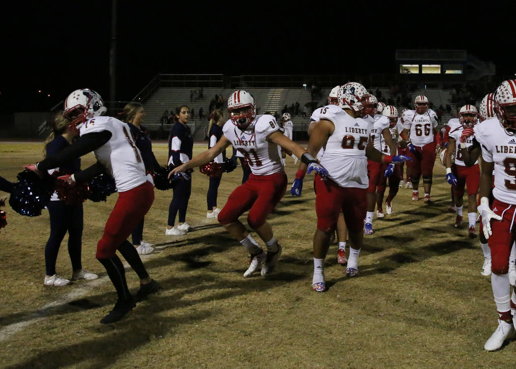 Liberty High players celebrate after winning 40-7 against Foothill High on Friday, Oct. 19 , 2018, in Henderson. Bizuayehu Tesfaye/Las Vegas Review-Journal @bizutesfaye