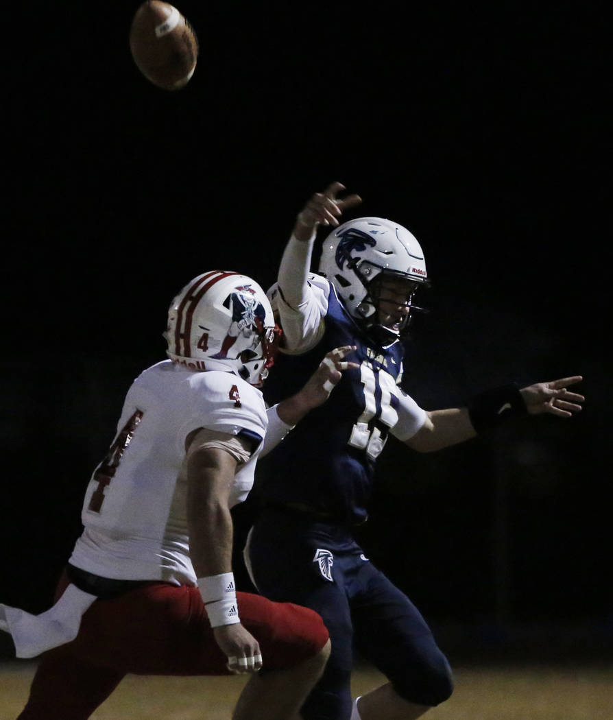 Liberty High's outside linebacker Kyle Beaudry (4) chases Foothill High's quarterback Koy Riggin (15) during their game on Friday, Oct. 19 , 2018, in Henderson. Liberty won 40-7. Bizuayehu Tesfaye ...