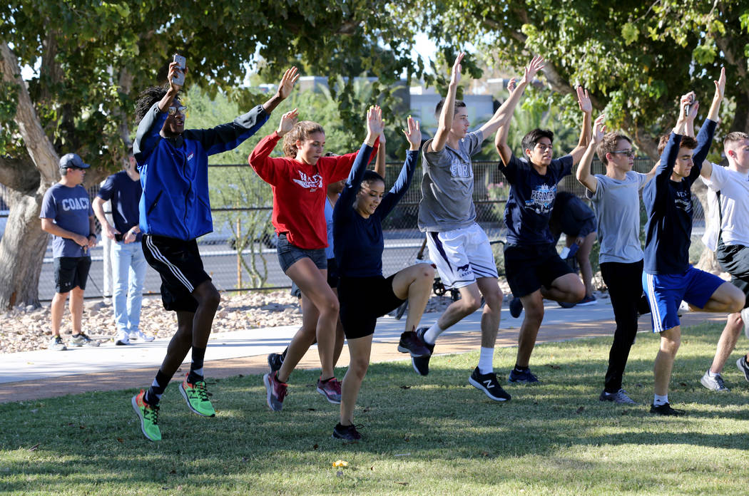 Valley High School cross country runner Christian Franklin, left, warms up for practice with his teammates at Justice Myron E. Leavitt Family Park in Las Vegas Wednesday, Oct. 24, 2018. K.M. Canno ...