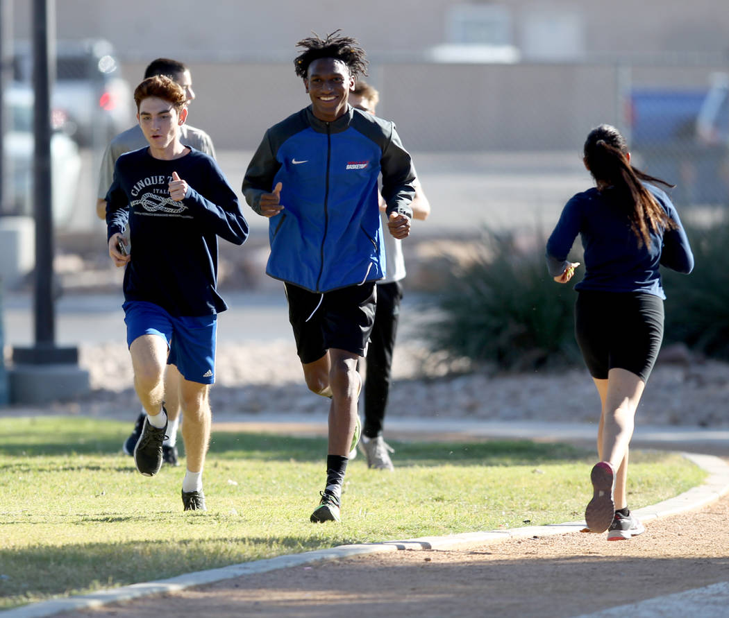 Valley High School cross country runner Christian Franklin, right, practices with teammate Donovan Jones at Justice Myron E. Leavitt Family Park in Las Vegas Wednesday, Oct. 24, 2018. K.M. Cannon ...