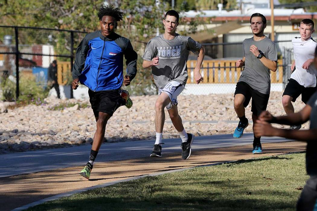 Valley High School cross country runner Christian Franklin, left, practices with his teammates at Justice Myron E. Leavitt Family Park in Las Vegas Wednesday, Oct. 24, 2018. K.M. Cannon Las Vegas ...