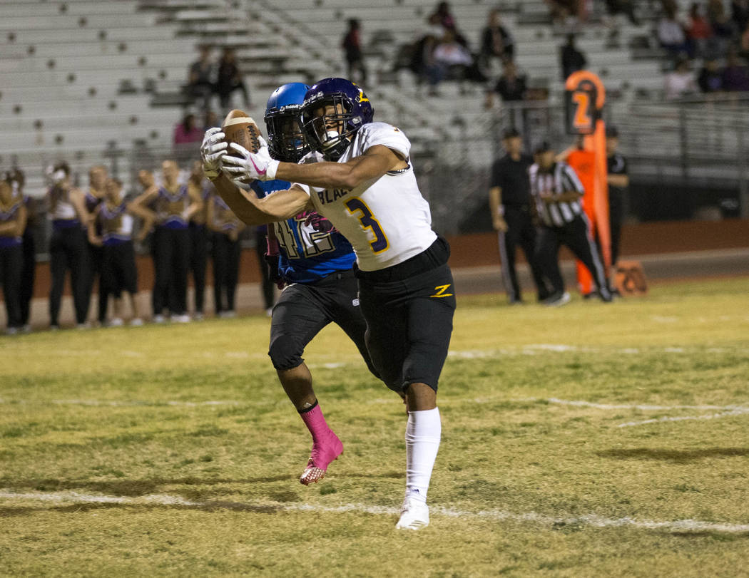 Durango wide receiver Michael Jackson (3) catches a pass in the end zone to score a touchdown in front of Sierra Vista's Camerion Murray (42) during the first half of a varsity football game at Si ...