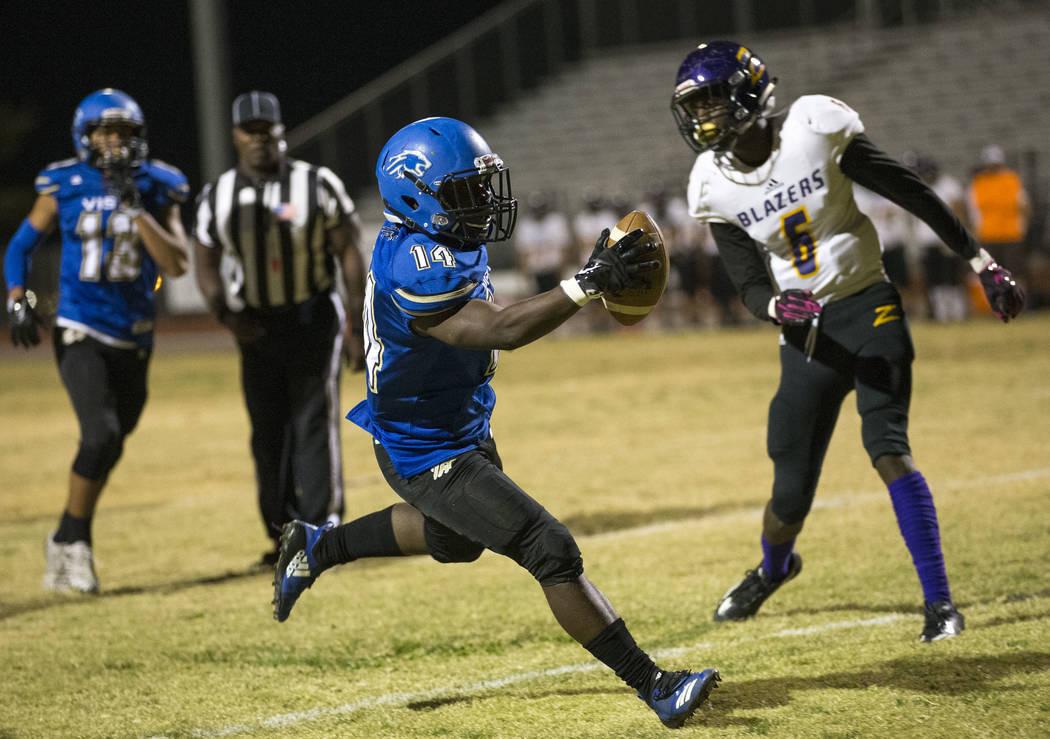 Sierra Vista's D'Andre Washington (14) scores a touchdown against Durango during the first half of a varsity football game at Sierra Vista High School in Las Vegas on Thursday, Oct. 25, 2018. Rich ...