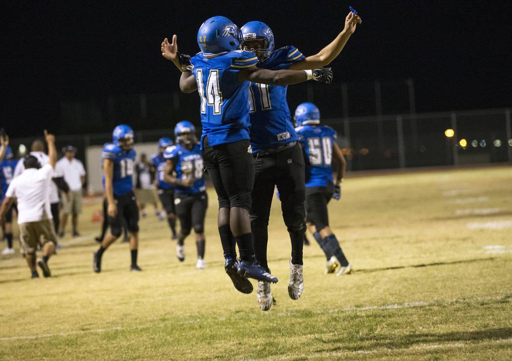 Sierra Vista's D'Andre Washington (14) celebrates with teammate Jordan Solomon (11) after scoring a touchdown against Durango during the first half of a varsity football game at Sierra Vista High ...
