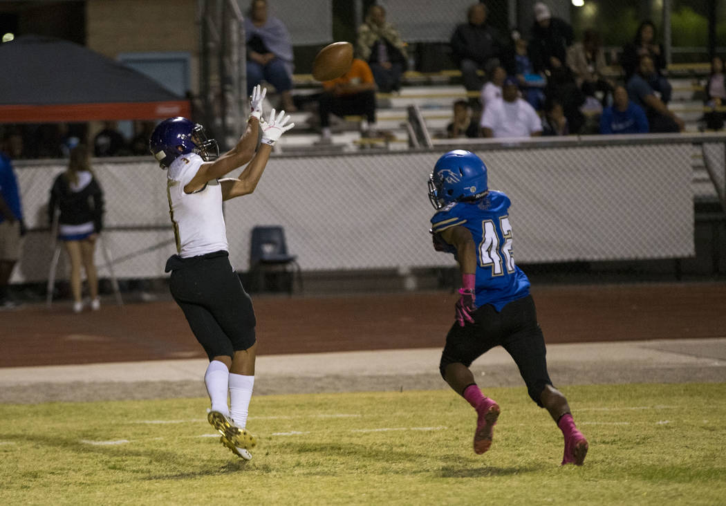 Durango wide receiver Michael Jackson (3) makes a catch for a touchdown over Sierra Vista's Camerion Murray (42) during the first half of a varsity football game at Sierra Vista High School in Las ...