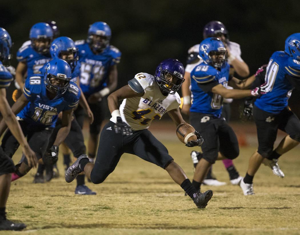 Durango's Tau Fotu (42) finds an opening through Sierra Vista defenders as he runs the ball for a touchdown during the second half of a varsity football game at Sierra Vista High School in Las Veg ...