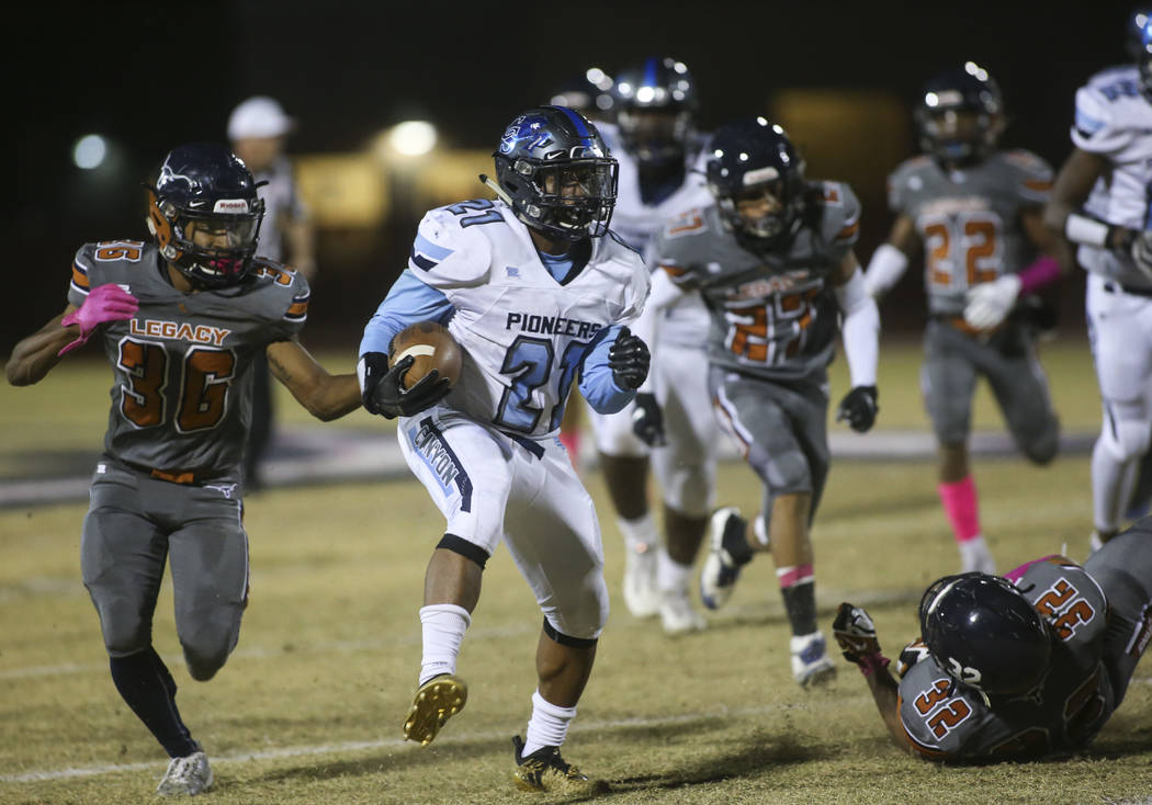 Canyon Springs' Elijah Alvarez (21) runs the ball during the first half of a football game at Legacy High School in North Las Vegas on Thursday, Oct. 25, 2018. Chase Stevens Las Vegas Review-Journ ...