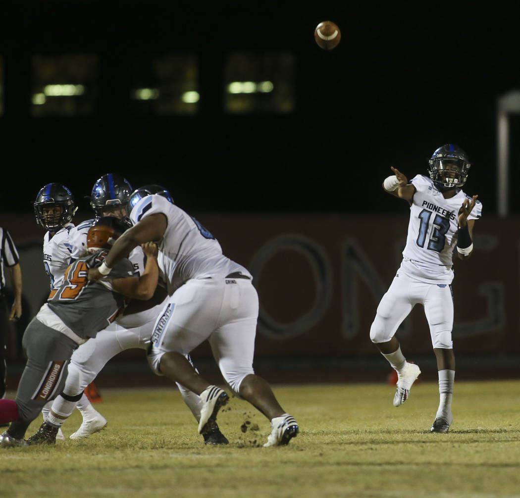 Canyon Springs' Aaron Holloway (13) throws a pass during the first half of a football game at Legacy High School in North Las Vegas on Thursday, Oct. 25, 2018. Chase Stevens Las Vegas Review-Journ ...