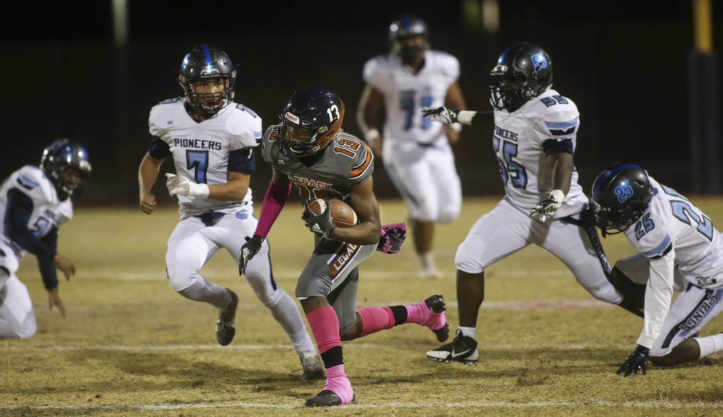 Legacy's Aaron Holloway (13) runs the ball against Canyon Springs during the first half of a football game at Legacy High School in North Las Vegas on Thursday, Oct. 25, 2018. Chase Stevens Las Ve ...