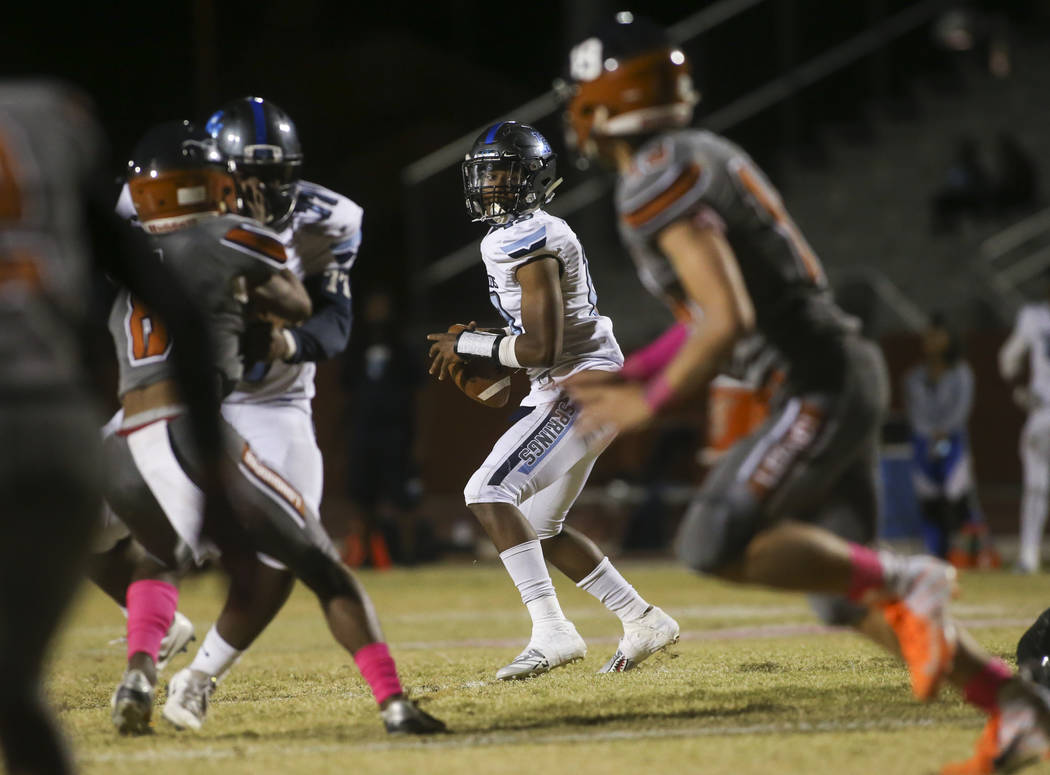 Canyon Springs' Aaron Holloway (13) looks for an open pass during the first half of a football game at Legacy High School in North Las Vegas on Thursday, Oct. 25, 2018. Chase Stevens Las Vegas Rev ...