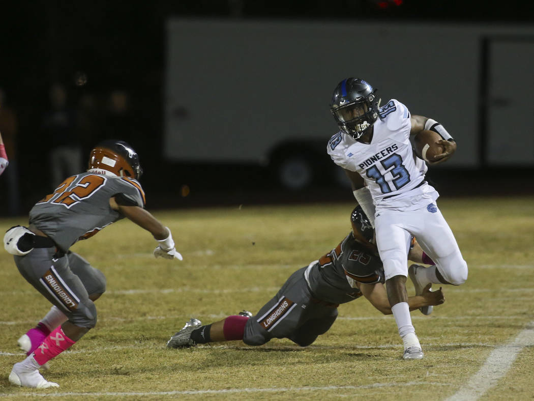 Legacy's Isaiah Sedillos (25) forces Canyon Springs' Aaron Holloway (13) out of bounds during the first half of a football game at Legacy High School in North Las Vegas on Thursday, Oct. 25, 2018. ...
