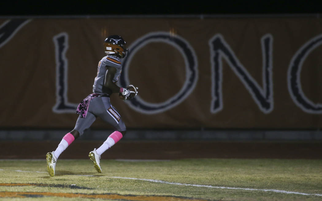 Legacy's Cahill Laws (17) scores a touchdown against Canyon Springs during the first half of a football game at Legacy High School in North Las Vegas on Thursday, Oct. 25, 2018. Chase Stevens Las ...