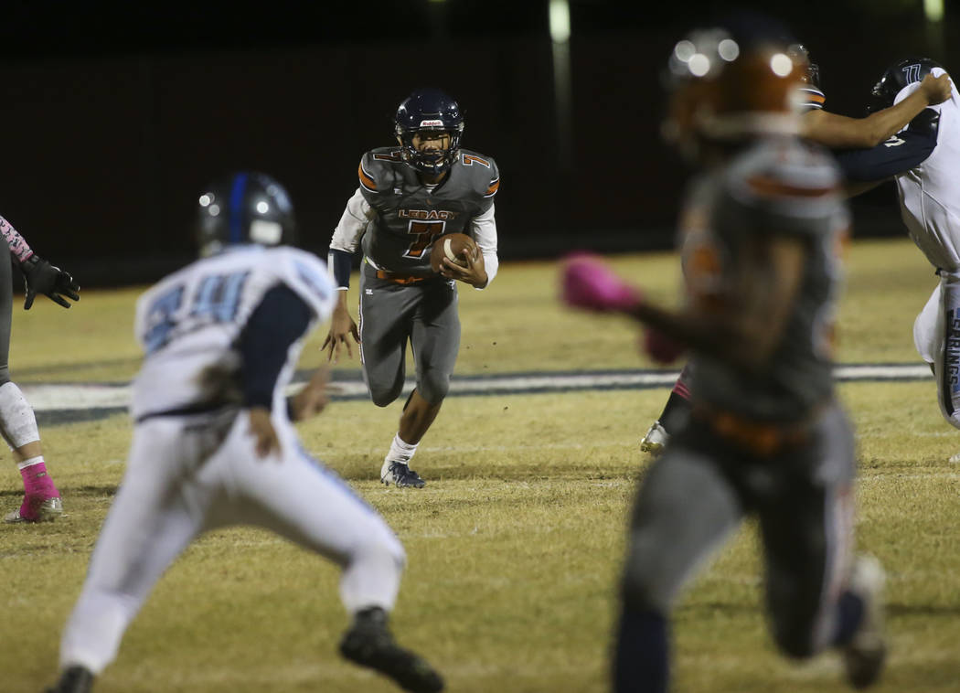 Legacy's Evan Olaes (7) runs the ball against Canyon Springs during the second half of a football game at Legacy High School in North Las Vegas on Thursday, Oct. 25, 2018. Chase Stevens Las Vegas ...