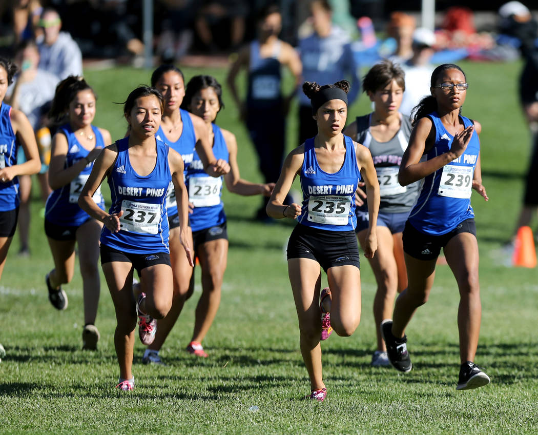 Desert Pines junior Jazmin Felix (235) leads her teammates at the start of the 4A Mountain girls cross country region race at Veteran's Memorial Park in Boulder City Friday, Oct. 26, 2018. K.M. Ca ...