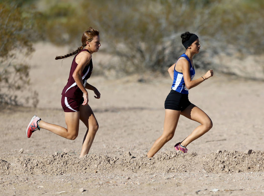 Desert Pines junior Jazmin Felix leads Cimarron-Memorial freshman Olivia Grace in the 4A Mountain girls cross country region race at Veteran's Memorial Park in Boulder City Friday, Oct. 26, 2018. ...