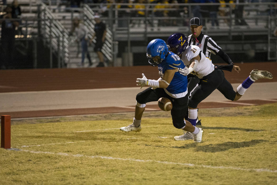Sierra Vista wide receiver Tristen Jimenez (16) gets stripped of the ball by Durango's Shan Fiorenza (21) as he heads for the end zone during the first half of a varsity football game at Sierra Vi ...