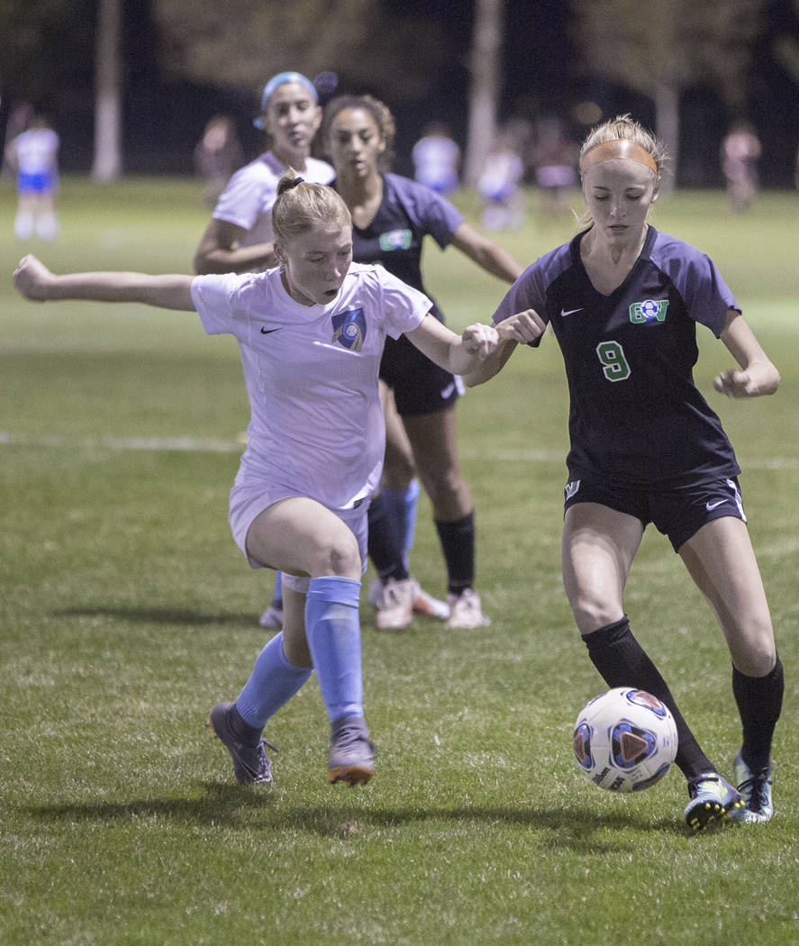 Foothill junior Haley Huff (2) fights for a loose ball Green Valley junior midfielder Grace Panik (9) in the first half on Wednesday, October 31, 2018, at Bettye Wilson Park, in Las Vegas. Benjami ...