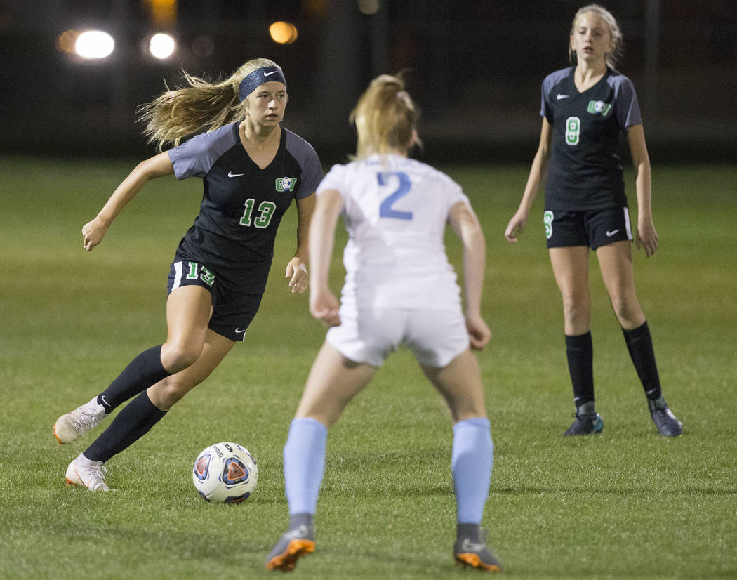 Green Valley sophomore midfielder Sydney Thomas (13) pushes the ball up field past Foothill junior Haley Huff (2) in the first half on Wednesday, October 31, 2018, at Bettye Wilson Park, in Las Ve ...