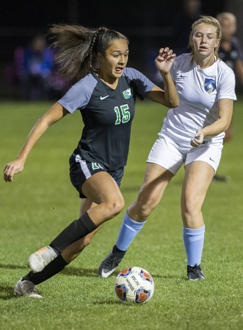 Green Valley junior forward Jazlyn Camacho (15) pushes the ball up field past Foothill sophomore Aqui Williams (13) in the second half on Wednesday, October 31, 2018, at Bettye Wilson Park, in Las ...