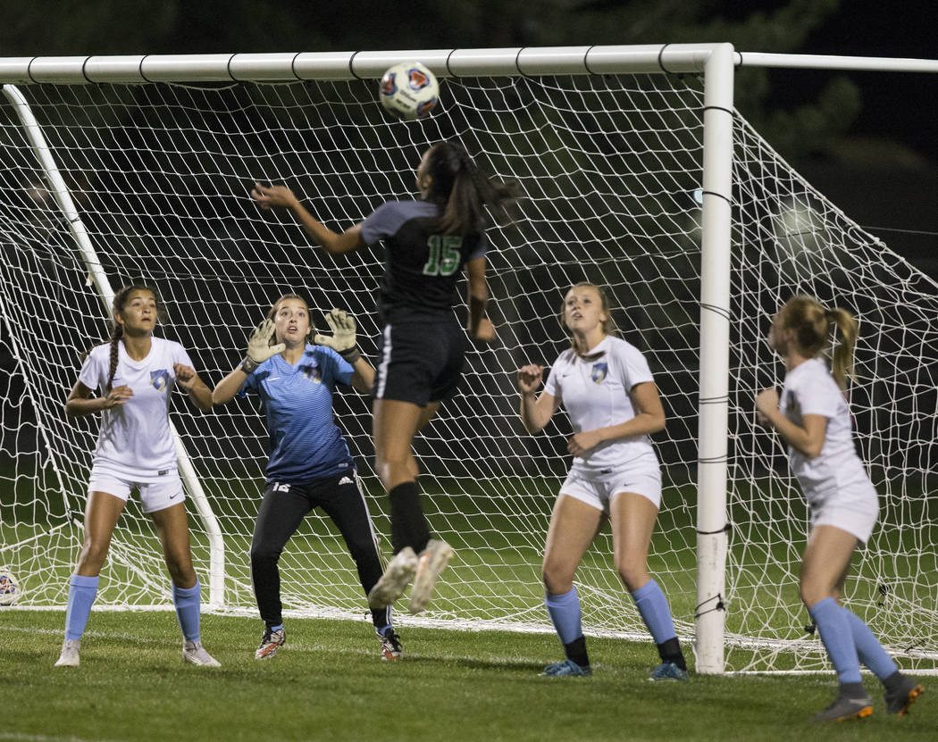 Green Valley junior forward Jazlyn Camacho (15) goes up for a header against Foothill High School defenders in the first half on Wednesday, October 31, 2018, at Bettye Wilson Park, in Las Vegas. B ...