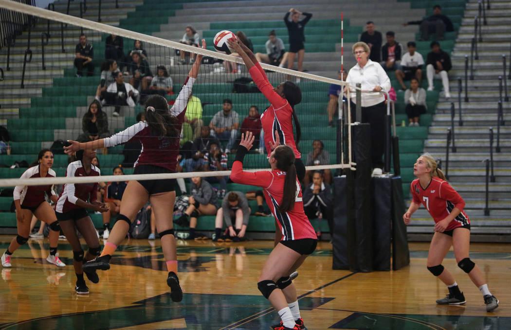 Las Vegas High School's Rimonee Wright hits the ball over the net against Cimarron Memorial High School at the Summerlin Center in Las Vegas, Wednesday, Oct. 31, 2018. Caroline Brehman/Las Vegas R ...