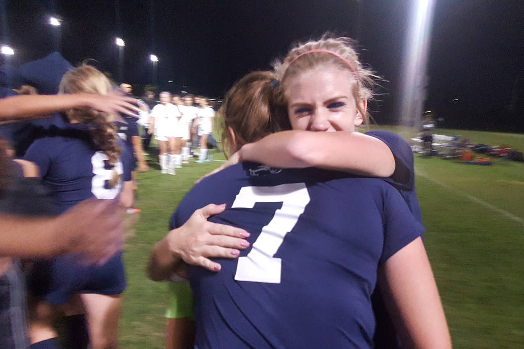 Centennial seniors Quincy Bonds and Marcella Brooks (7) embrace after the Bulldogs' 3-2 overtime victory against Shadow Ridge on Wednesday at Bettye Wilson Complex, in the Class 4A Mountain Region ...