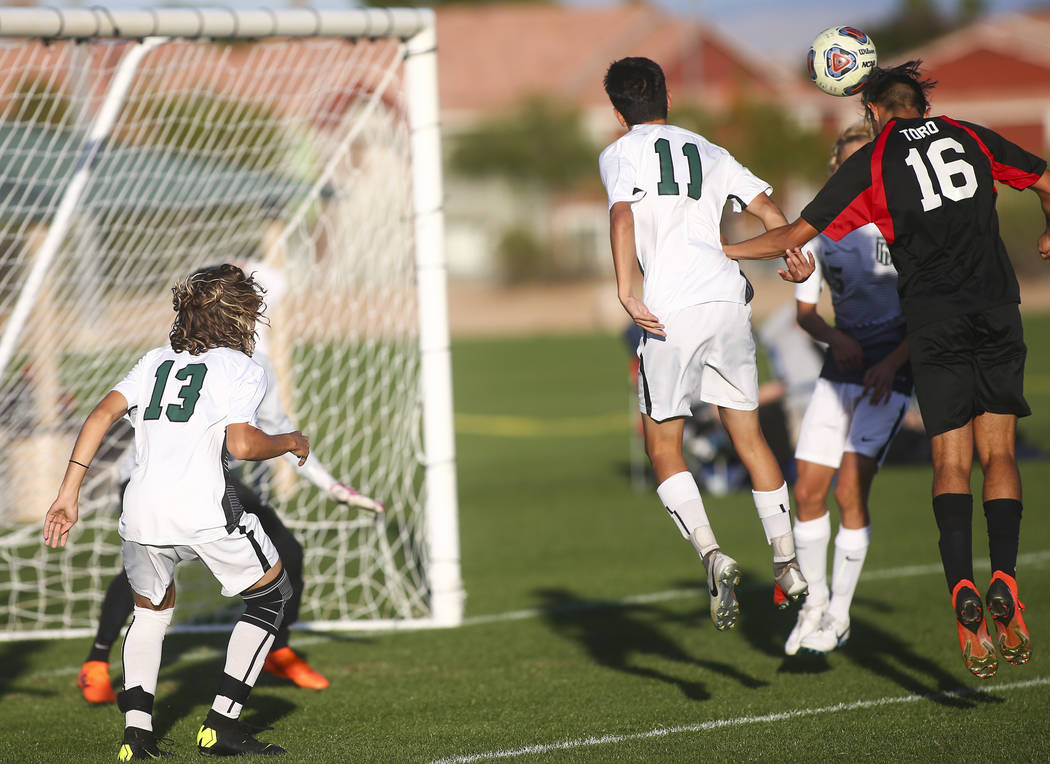 Las Vegas' Nathan Zamora (16) heads the ball past Palo Verde defenders to score a goal during the Mountain Region boys soccer semifinal match at the Bettye Wilson Soccer Complex in Las Vegas on Th ...