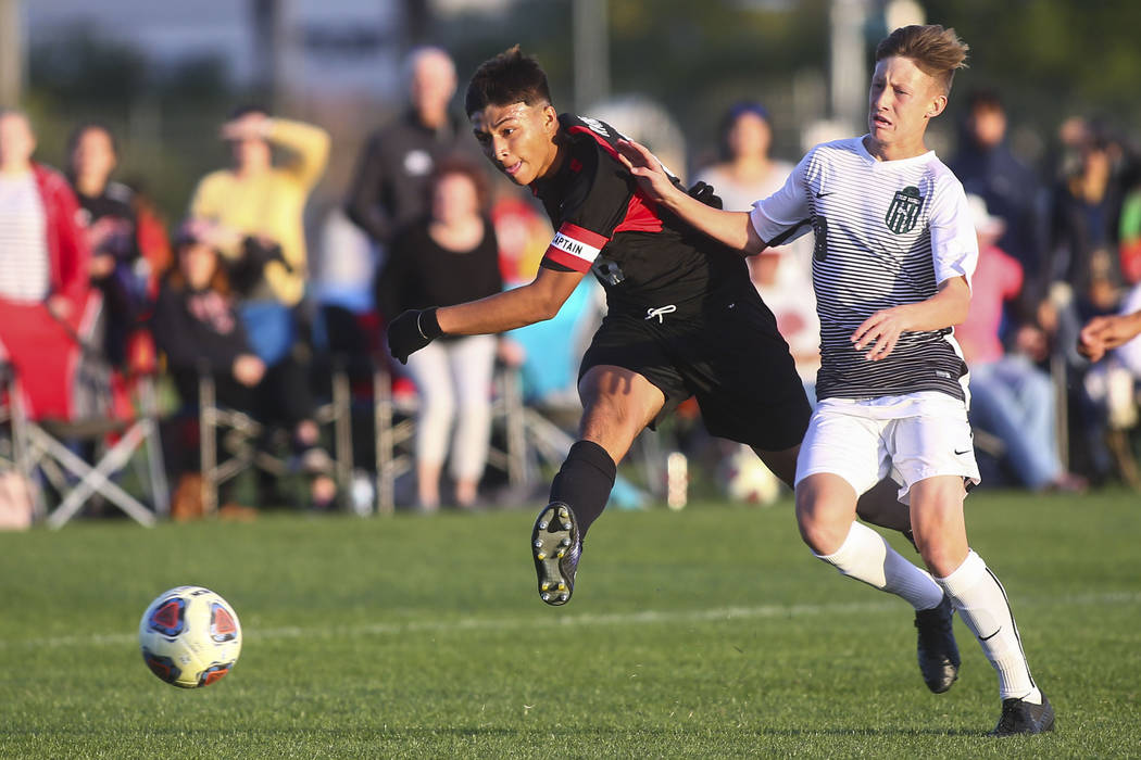Las Vegas' Daniel Rangel (8) kicks the ball past Palo Verde's Luke McGee to score a goal during the Mountain Region boys soccer semifinal match at the Bettye Wilson Soccer Complex in Las Vegas on ...
