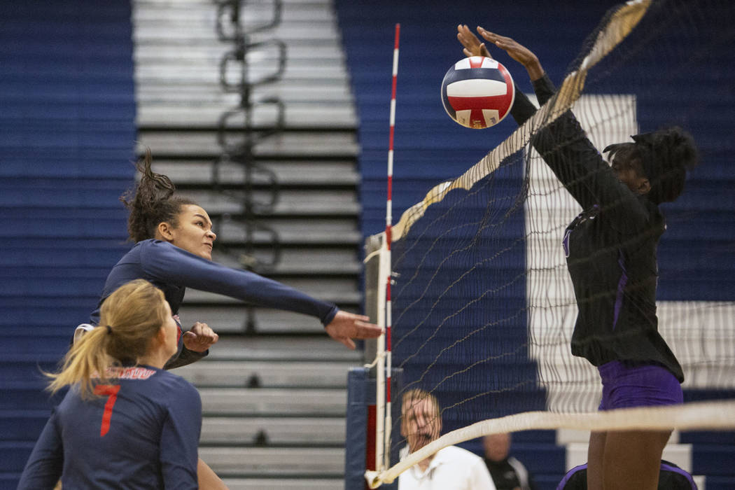 Durango's Shakayla Scarbrough blocks the ball after Coronado's Brooke Dobson sends it over the net for the Desert Region girls volleyball semifinal at Coronado High School in Henderson, Thursday, ...