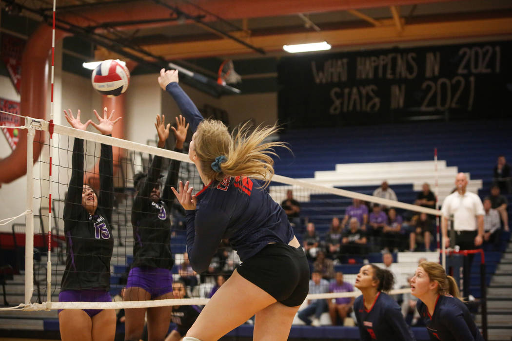 Coronado's Sasha Bolla hits the ball over the net as Durango's Anuhea Faitau, left, and Shakayla Scarbrough attempt to block it during the Desert Region girls volleyball semifinal at Coronado High ...