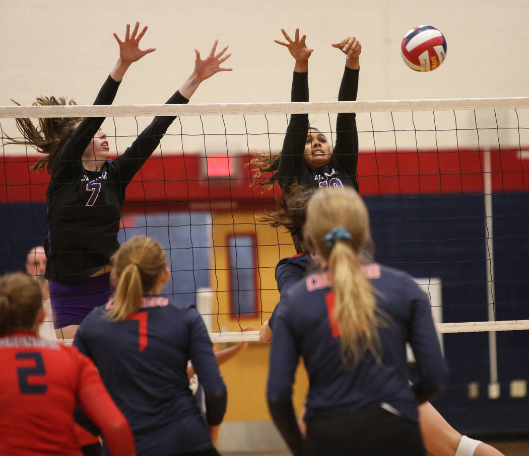 Durango's Lindsay McMahon, left, and Tatiana Johnson attempt to block the ball during the Desert Region girls volleyball semifinal at Coronado High School in Henderson, Thursday, Nov. 1, 2018. Car ...
