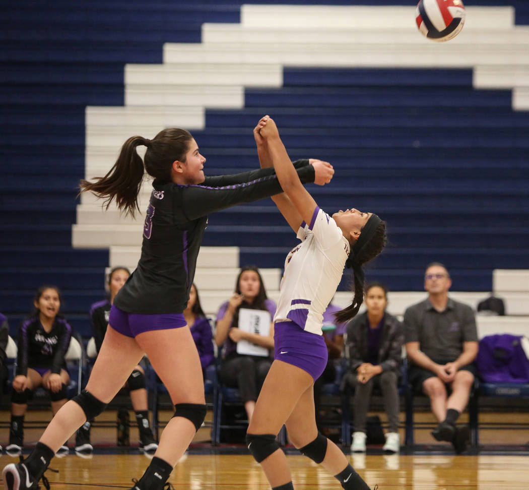 Durango's Sophia Dominguez, left, and Sierra Leone Sanchez go to return the ball during the Desert Region girls volleyball semifinal at Coronado High School in Henderson, Thursday, Nov. 1, 2018. C ...