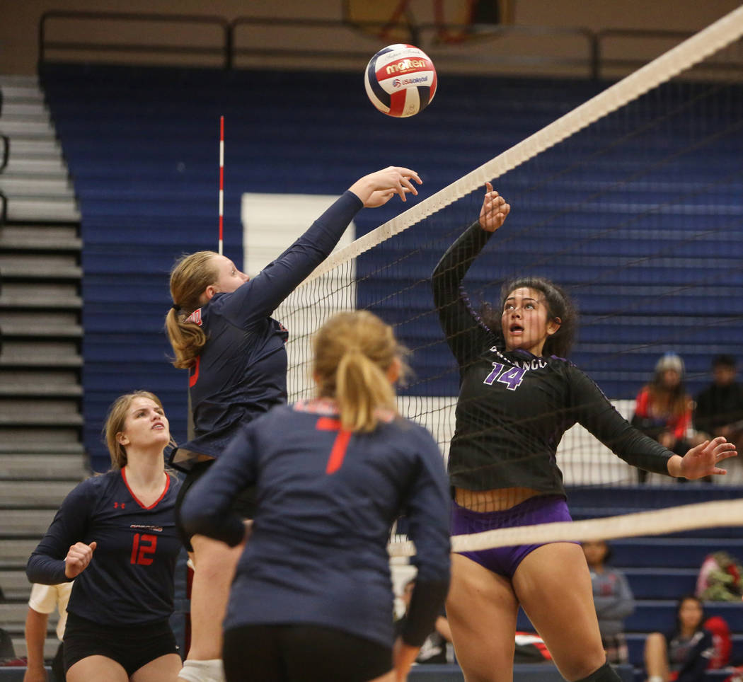 Coronado's Aspen Steele hits the ball as Durango's Tehani Faitau jumps up to return it during the Desert Region girls volleyball semifinal at Coronado High School in Henderson, Thursday, Nov. 1, 2 ...
