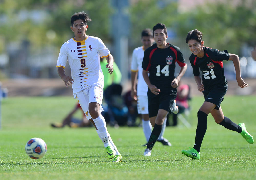Eldorado High School's Jose Torres (9) dribbles the ball in the second half of the 3A Mountain Region Championship soccer game between Las Vegas High School and Eldorado High School in Las Vegas o ...