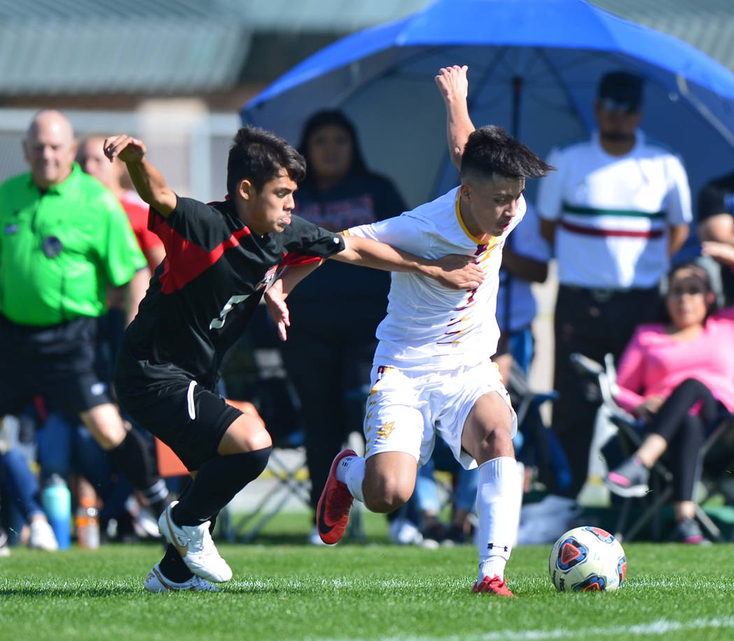 Las Vegas High School's Sebastian Contreras (5) battles for the ball with Eldorado High School's Sebastian Ramirez (7) in the second half of the 3A Mountain Region Championship soccer game between ...