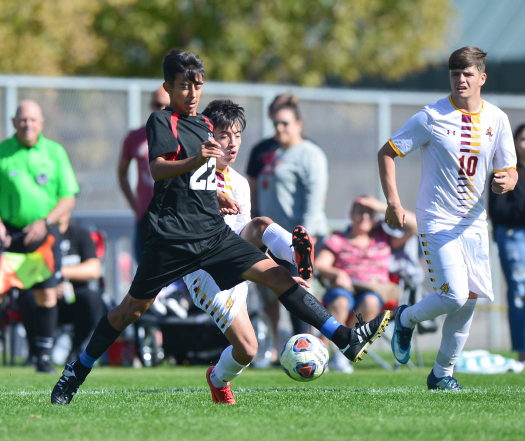 Las Vegas High School's Julian Hernandez (22) passes the ball in front of Eldorado High School's Sebastian Ramirez (7) of the 3A Mountain Region Championship soccer game between Las Vegas High Sch ...