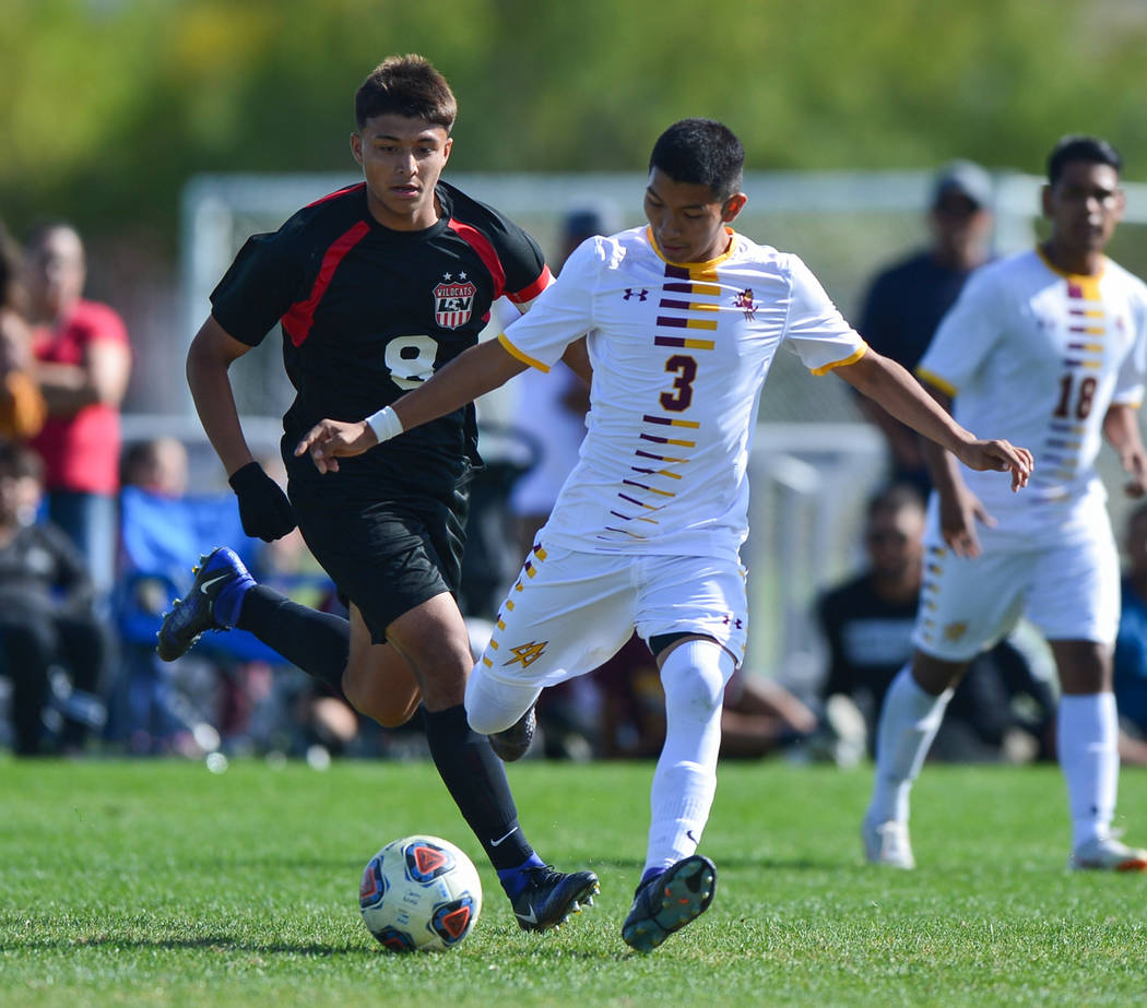 Eldorado High School's Juan Leon (3) passes the ball in front of Las Vegas High School's Daniel Rangel (8) in the second half of the 3A Mountain Region Championship soccer game between Las Vegas H ...