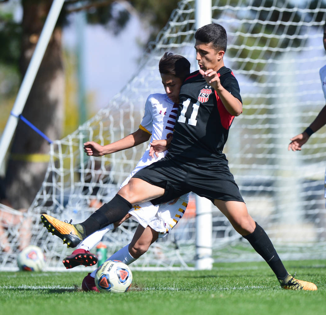 Las Vegas High School's Rigo Carrasco (11) fouls Eldorado High School's Jesus Espejo (6) in the second half of the 3A Mountain Region Championship soccer game between Las Vegas High School and Eld ...