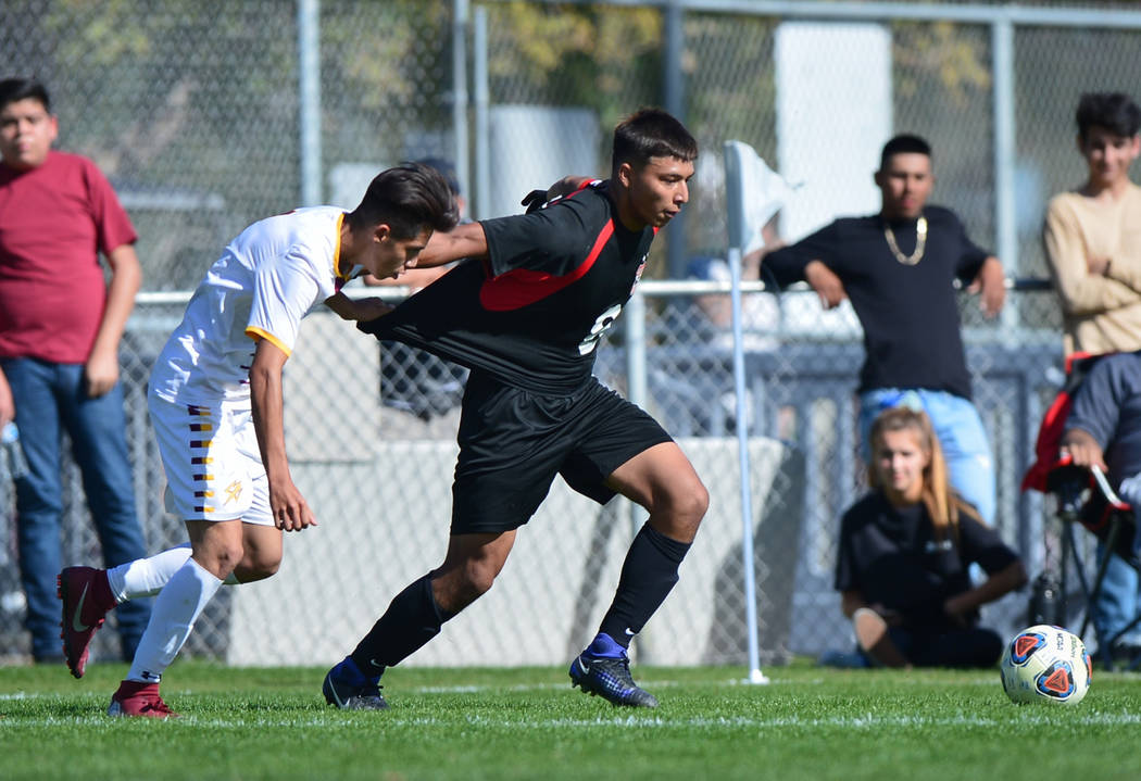 Eldorado' High School's Jesus Espejo (6) tugs on the jersey of Las Vegas High School's Daniel Rangel (8) in the second half of the 3A Mountain Region Championship soccer game between Las Vegas Hig ...