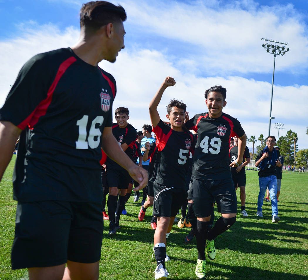 The Las Vegas High School soccer team celebrates winning the the 3A Mountain Region Championship over Eldorado High School 2-0 in Las Vegas on Saturday, Nov. 3, 2018. Las Vegas High School beat El ...