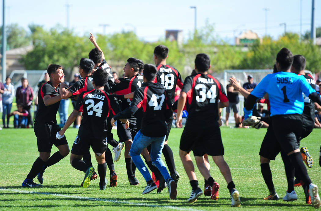 The Las Vegas High School soccer team storms the field after winning the 3A Mountain Region Championship over Eldorado High School 2-0 in Las Vegas on Saturday, Nov. 3, 2018. Brett Le Blanc Las Ve ...