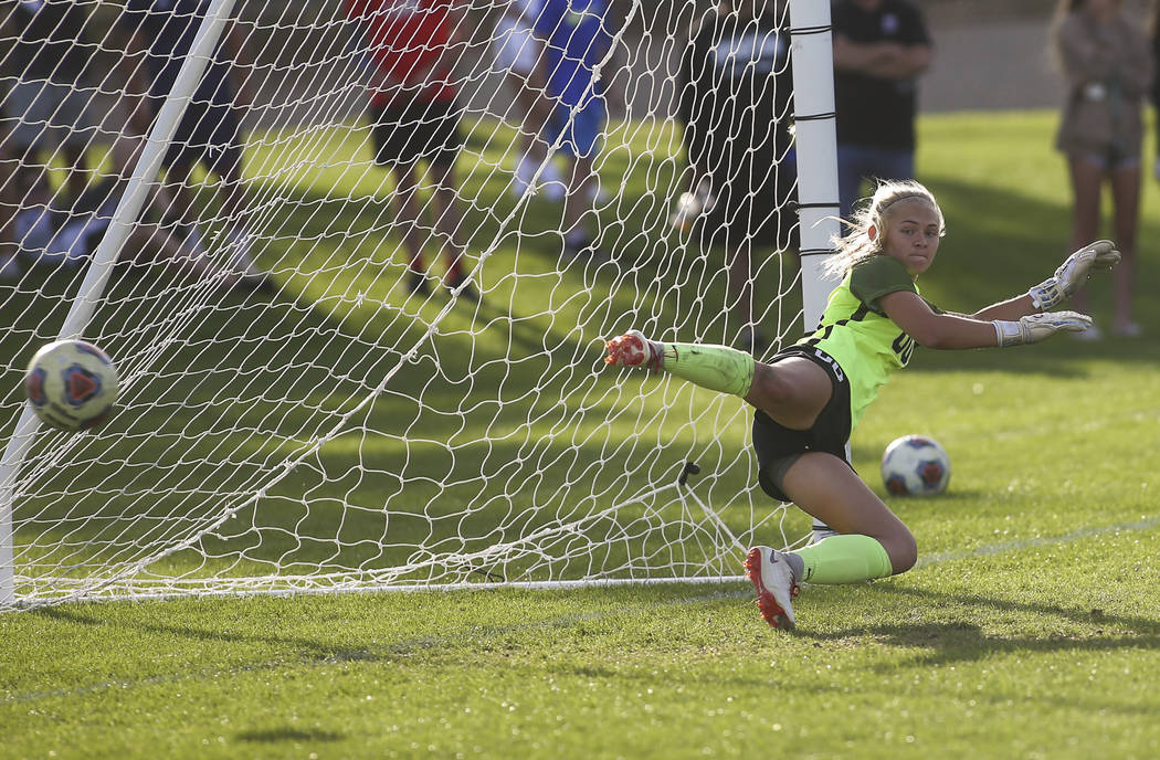 Coronado's Taylor Book gives up the game ending goal from Bishop Gorman in a penalty shootout during the Desert Region girls soccer championship game at Bettye Wilson Soccer Complex in Las Vegas o ...