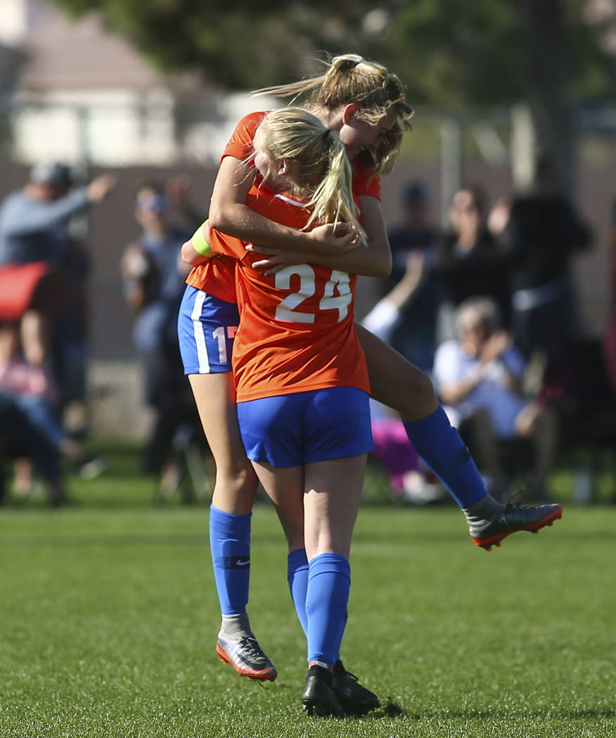 Bishop Gorman's Kevyn Hillegas (24) celebrates her goal with Bishop Gorman's Colbi Rohr (17) during the Desert Region girls soccer championship game against Coronado at Bettye Wilson Soccer Comple ...