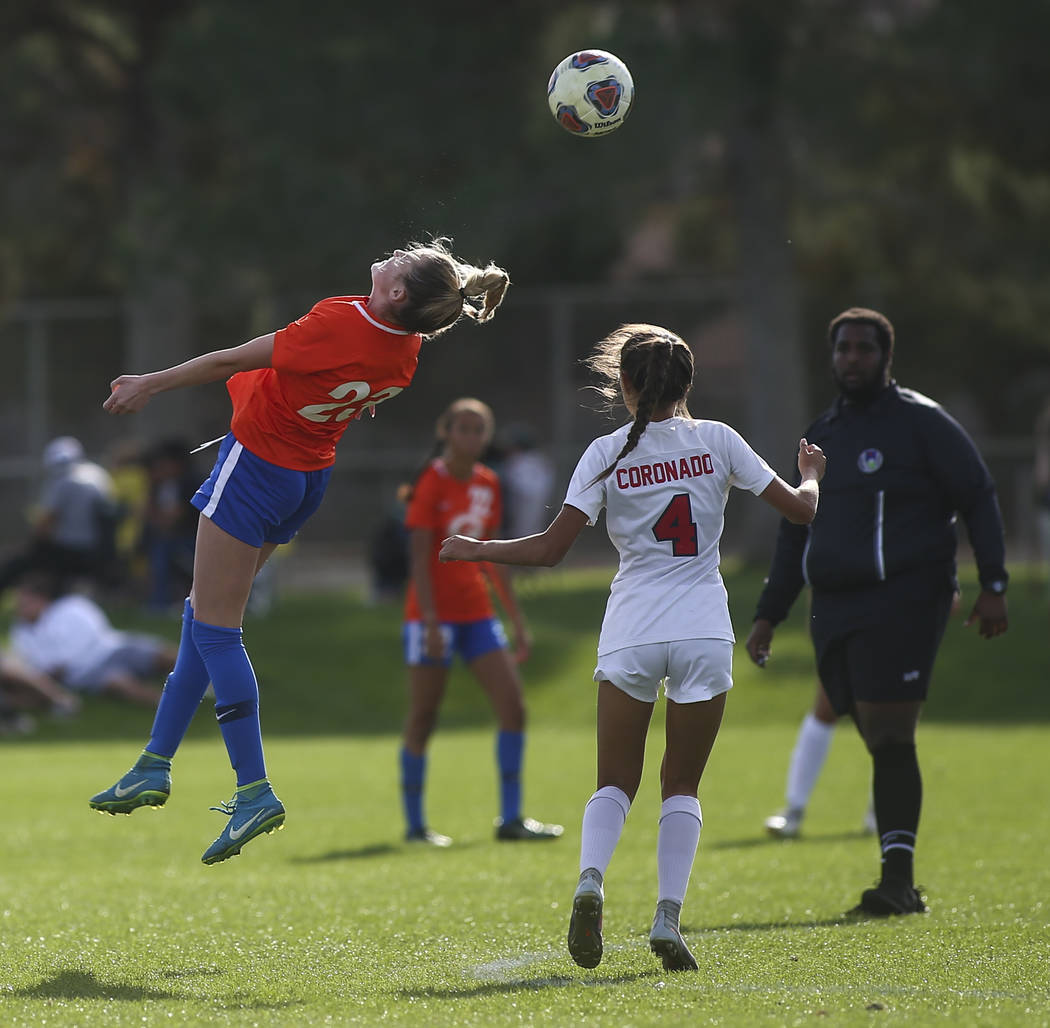 Bishop Gorman's Jacqueline Hillegas (23) heads the ball past Coronado's Chrysta Vasquez (4) during the Desert Region girls soccer championship game at Bettye Wilson Soccer Complex in Las Vegas on ...