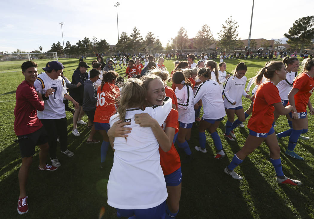 Bishop Gorman players celebrate their win over Coronado in the Desert Region girls soccer championship game at Bettye Wilson Soccer Complex in Las Vegas on Saturday, Nov. 3, 2018. Chase Stevens La ...