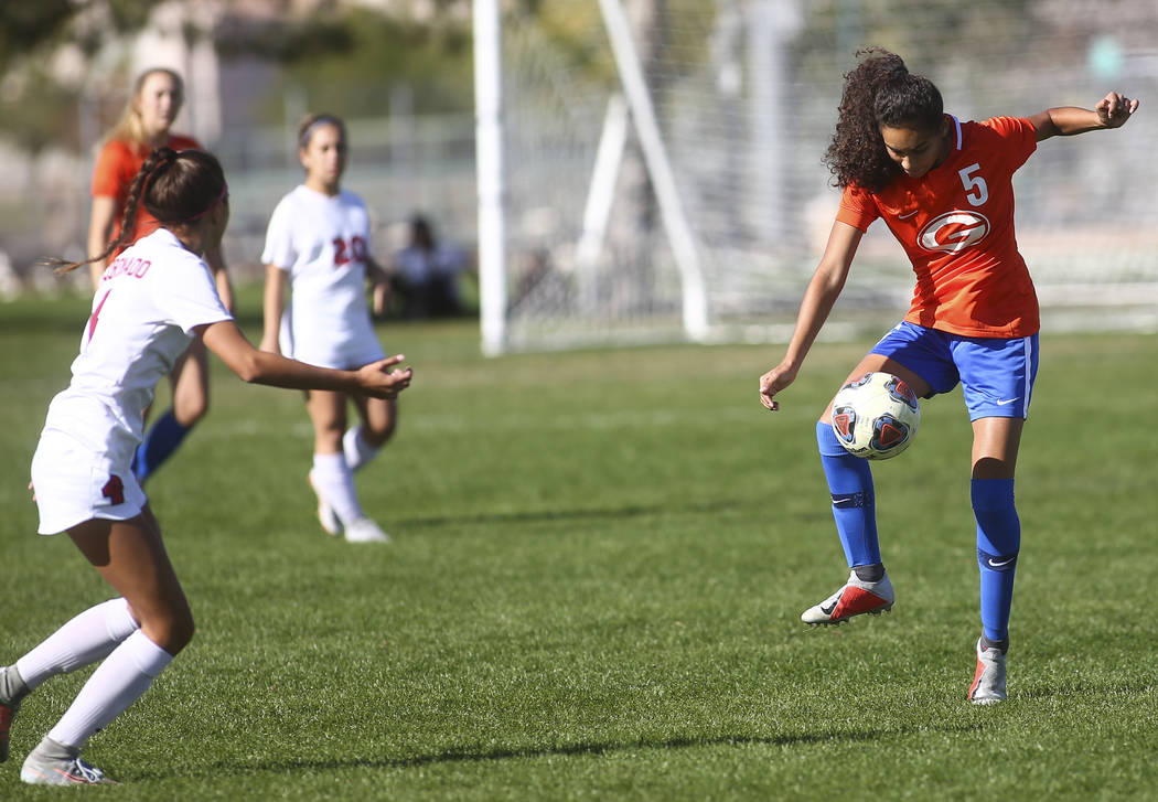 Bishop Gorman's Samantha Nieves (5) kicks the ball past Coronado during the Desert Region girls soccer championship game at Bettye Wilson Soccer Complex in Las Vegas on Saturday, Nov. 3, 2018. Cha ...